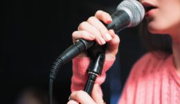 Mic and unrecognizable female singer close up